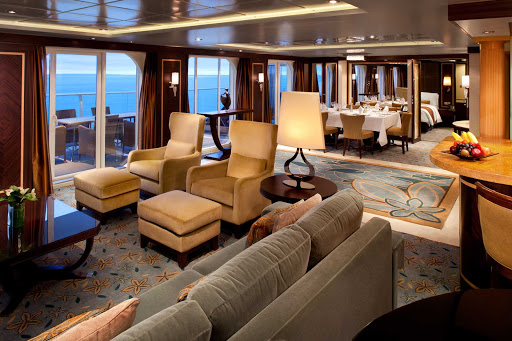 Oasis-of-the-Seas-Stateroom-Royal-Suite - The Royal Suite on Oasis of the Seas features a grand entrance,  master bedroom with queen bed and sitting area, master bathroom, spacious living room with a sofa that converts into a double bed, a separate guest bathroom, an entertainment center and dining room.