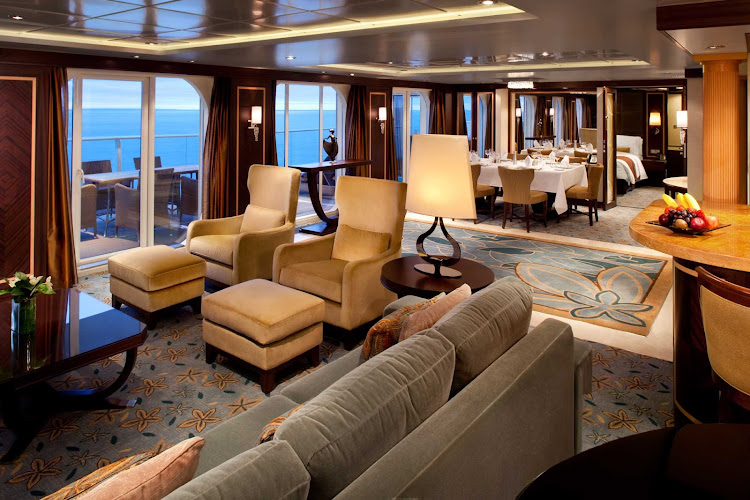 The Royal Suite on Oasis of the Seas features a grand entrance,  master bedroom with queen bed and sitting area, master bathroom, spacious living room with a sofa that converts into a double bed, a separate guest bathroom, an entertainment center and dining room.