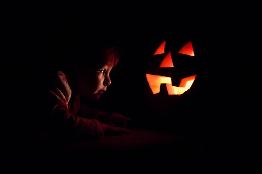 That's Spooky by Laura Robles - Public Holidays Halloween ( child, candlelight, pumpkin, jack o'lantern, portrait, halloween, , carved )