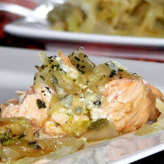 Grilled Salmon Steak with Cheesy Sauce.