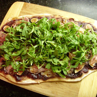 Fresh Fig Jam Flatbread with Roasted Figs, Prosciutto, Manchego and Arugula.
