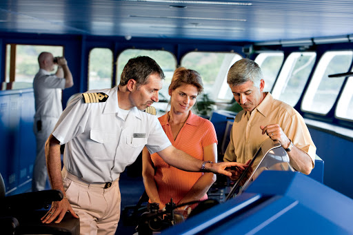 Captain Mirkovic explains an instrument panel on the bridge of the Gauguin.