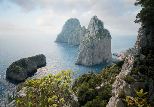 faraglioni-capri-italy - The Faraglioni of Capri, Italy, are three geological stacks that have survived earthquakes and landslides.