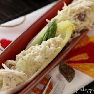 Citrus Fennel Chicken Salad Endive Boats with Goat Cheese, Asparagus and Pecans.