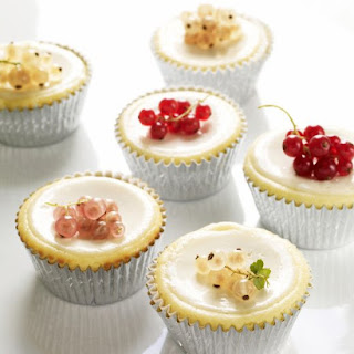 Cheesecake Cupcakes with Sour Cream Topping.
