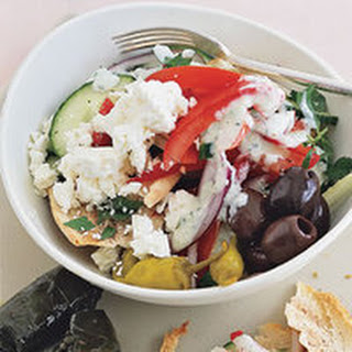 Greek Fit-for-the-Gods Salad with Spicy Cucumber Dressing and Pita Chips.